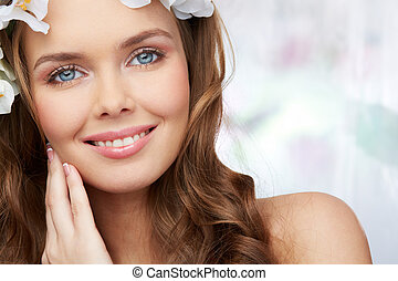 Spring portrait of a woman with magnificent blue eyes