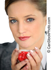 Blue eyed woman drinking a cup of expresso