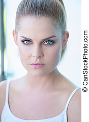 Blue eyed young woman staring intently