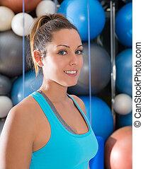 Blue eyes beautiful girl smiling at gym portrait