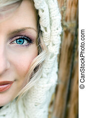 Beautiful young woman portrait with blue eyes and muffler