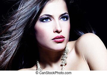 Glamorous beauty blue eyes woman portrait, dark background, studio shot