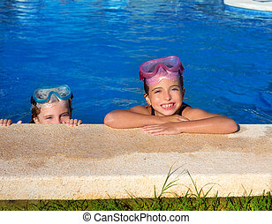 Blue eyes children girls on on blue pool poolside smiling