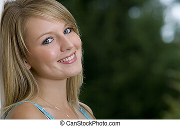 Blue Eyes & Smiling - A beautiful young woman with bright...