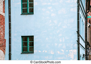 blue facade of old house on street in Riga city