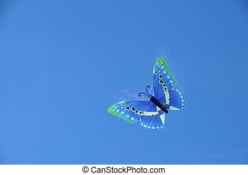 Fake butterfly on blue sky background