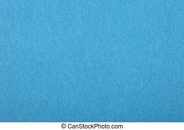 Blue felt background texture close up