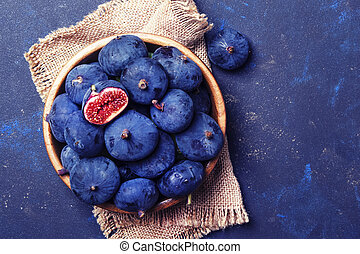 Blue figs on blue stone background, top view