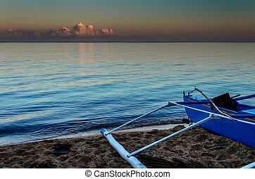 Blue Fishing Boat at Sunset
