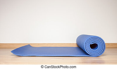 blue fitness and yoga mat
