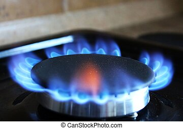 Blue flame from a gas burner - A close-up photo of blue...