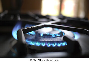 blue flame of gas in kitchen