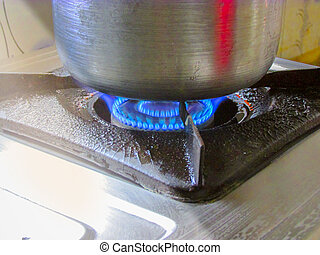 Blue Flame of gas ove when cooking is going on.