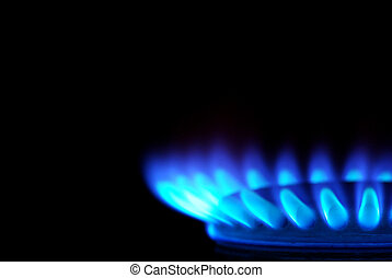 gas  - Blue flames of gas stove in the dark
