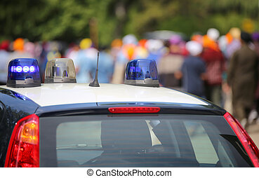 blue flashing lights of the police car