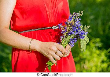 Blue flower bouquet in female hand