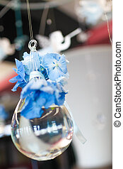 Blue flowers suspended in a glass bowl