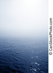 Blue fog sea in a foggy day with low ocean visibility