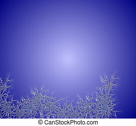 Border of blue frost against a wintry blue background