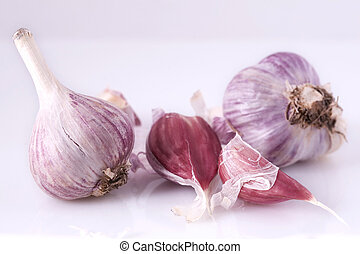 garlic - blue garlic laying on white background
