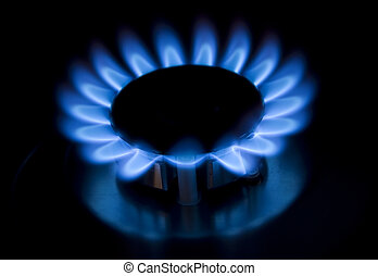 blue gas flames of a burner with black background