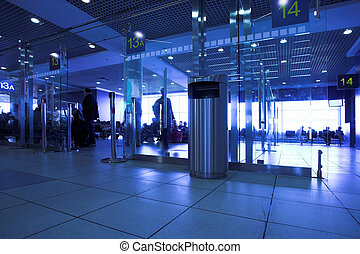 Blue gates in airport terminal