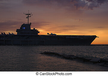 Blue Ghost - USS Lexington aircraft carrie is silhouetted...