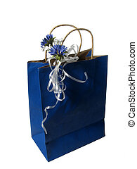 blue gift bag with ribbon and flowers isolated on white...