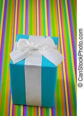 blue gift box on striped colored background