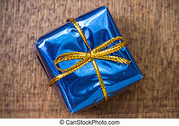 Blue gift box on the board
