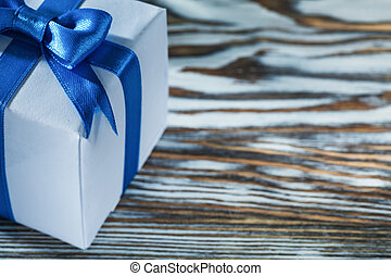 Blue gift box on wooden board
