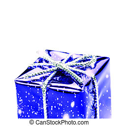 Blue gift box with silver ribbon, bow and snowflakes isolated on white macro. Christmas, Valentine's, Birthday gift box