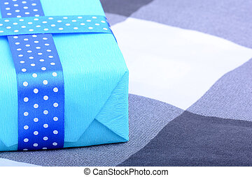 blue gift box with white ribbon
