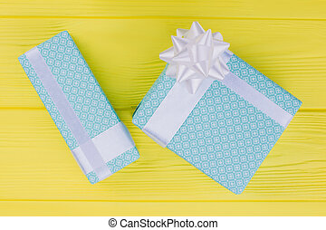 Blue gift boxes on vibrant background.