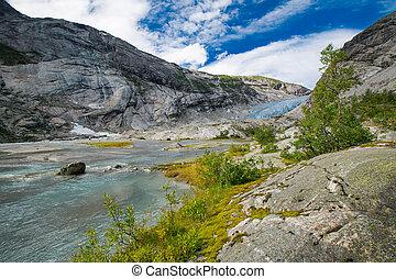 Blue glacier with lake Nigardsbreen