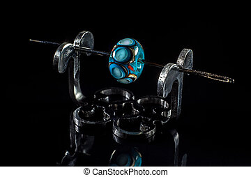 Blue glass bead on stand