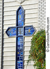 Blue glass cross - Blue glass squares and rectangles form...