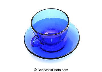 Blue glass empty tea cup.