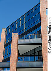 Blue Glass Office Tower with Red Brick Columns