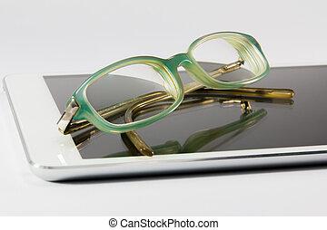 blue glasses on digital tablet pc