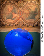 Blue globe against map of the world.