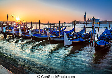 Blue gondolas at sunrise in Venice