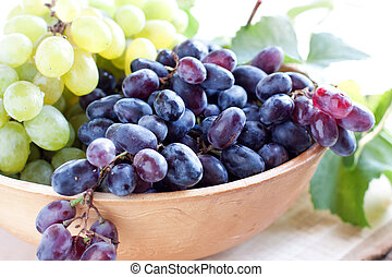 Blue grapes in a clay bowl