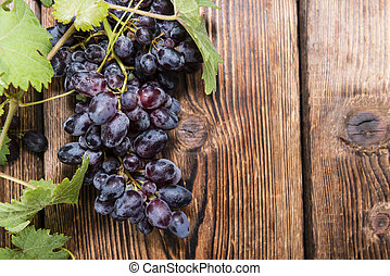 Blue Grapes (on wooden background)
