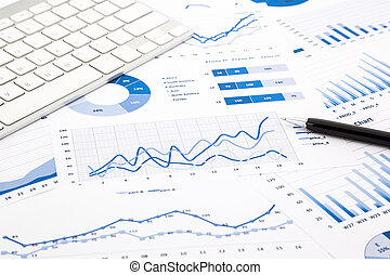 blue graph and chart reports on office table - closeup blue...
