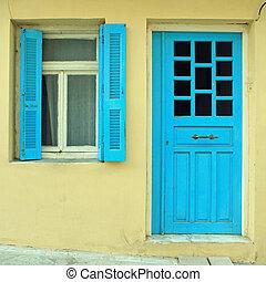Blue greek shutters window and door in old house, Greece. ...
