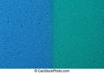 blue green plastic background of a piece of foam rubber