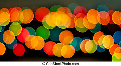 Blue, green, yellow and red bokeh, soft light abstract background.