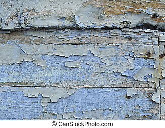 wooden plank with blue peeling paint