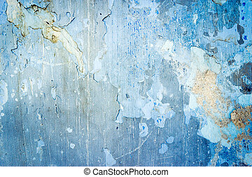 Blue grunge textured wall closeup